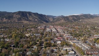 DX0001_001921 - 5.7K stock footage aerial video fly away from and flyby Boulder, Colorado with mountains in background