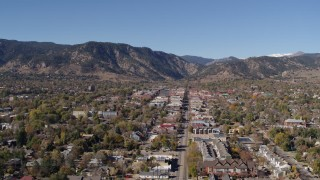 DX0001_001922 - 5.7K stock footage aerial video ascend and flyby Boulder, Colorado with mountains in background