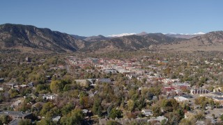 DX0001_001923 - 5.7K stock footage aerial video descend and flyby Boulder, Colorado with mountains in background