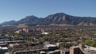DX0001_001926 - 5.7K stock footage aerial video flyby the University of Colorado Boulder during descent, with Green Mountain in the background