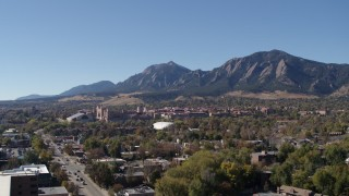 DX0001_001927 - 5.7K stock footage aerial video flyby the University of Colorado Boulder during ascent, with Green Mountain in background