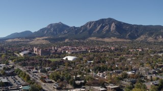DX0001_001933 - 5.7K stock footage aerial video approach the University of Colorado Boulder and Green Mountain in distance