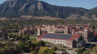 DX0001_001939 - 5.7K stock footage aerial video flyby of part of the University of Colorado Boulder campus during descent