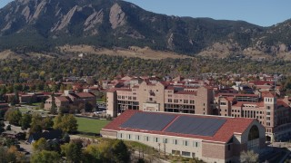 DX0001_001940 - 5.7K stock footage aerial video flyby of part of the University of Colorado Boulder campus during ascent