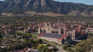 DX0001_001943 - 5.7K stock footage aerial video ascend and flyby campus buildings at the University of Colorado Boulder