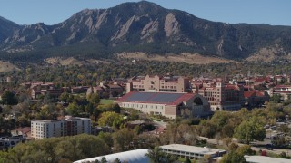 DX0001_001944 - 5.7K stock footage aerial video flyby campus buildings at the University of Colorado Boulder while descending