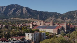 DX0001_001945 - 5.7K stock footage aerial video ascend while passing campus buildings at the University of Colorado Boulder