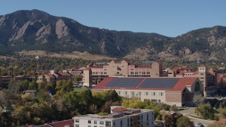 DX0001_001946 - 5.7K stock footage aerial video descend while passing campus buildings at the University of Colorado Boulder