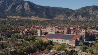 DX0001_001947 - 5.7K stock footage aerial video ascend for view of campus buildings at the University of Colorado Boulder