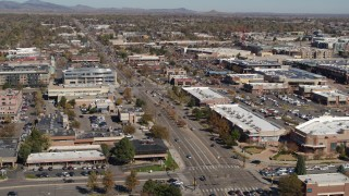 DX0001_001948 - 5.7K stock footage aerial video of a strip mall beside a wide street in Boulder, Colorado