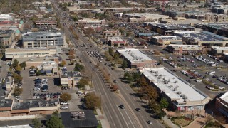 DX0001_001949 - 5.7K stock footage aerial video of reverse view of a strip mall beside a wide street in Boulder, Colorado