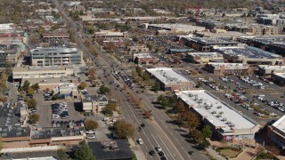 DX0001_001950 - 5.7K stock footage aerial video approach a strip mall beside a wide street in Boulder, Colorado
