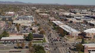 DX0001_001951 - 5.7K stock footage aerial video fly away from cars crossing an intersection in Boulder, Colorado
