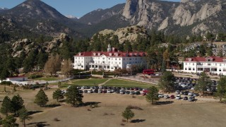 DX0001_001957 - 5.7K stock footage aerial video of flying by the historic Stanley Hotel in Estes Park, Colorado while ascending