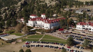 DX0001_001958 - 5.7K stock footage aerial video of passing by the historic Stanley Hotel in Estes Park, Colorado