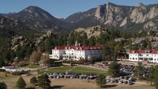 DX0001_001961 - 5.7K stock footage aerial video of passing the historic Stanley Hotel in Estes Park, Colorado