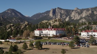 DX0001_001962 - 5.7K stock footage aerial video of the historic Stanley Hotel in Estes Park, Colorado, mountains in background