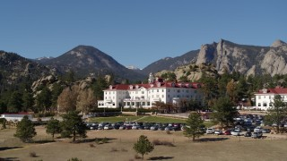 DX0001_001966 - 5.7K stock footage aerial video fly low by the historic Stanley Hotel in Estes Park, Colorado