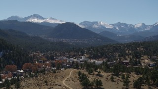 DX0001_001968 - 5.7K stock footage aerial video of the Rocky Mountains seen from the town of Estes Park, Colorado