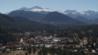 DX0001_001971 - 5.7K stock footage aerial video of the Rocky Mountains and the town of Estes Park, Colorado while ascending
