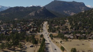 DX0001_001975 - 5.7K stock footage aerial video of cars on a road through the town of Estes Park, Colorado