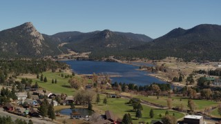 DX0001_001978 - 5.7K stock footage aerial video of Lake Estes by golf course and green mountains in Estes Park, Colorado
