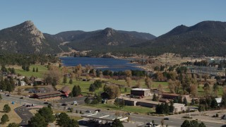 DX0001_001983 - 5.7K stock footage aerial video ascend for wider view of Lake Estes, golf course and green mountains in Estes Park, Colorado