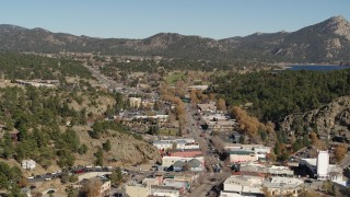 DX0001_001996 - 5.7K stock footage aerial video flyby shops lining road through Estes Park, Colorado while descending