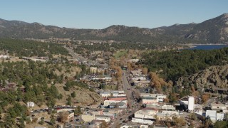 DX0001_001997 - 5.7K stock footage aerial video flyby shops lining road through Estes Park, Colorado while ascending