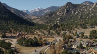 DX0001_002000 - 5.7K stock footage aerial video of rural homes near rugged mountains in Estes Park, Colorado