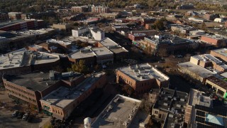 DX0001_002010 - 5.7K stock footage aerial video of a reverse view of brick office buildings and shops in Fort Collins, Colorado