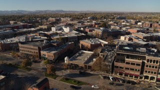 DX0001_002014 - 5.7K stock footage aerial video passing by brick office buildings and shops in Fort Collins, Colorado