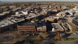 DX0001_002015 - 5.7K stock footage aerial video a view of brick office buildings and shops in Fort Collins, Colorado