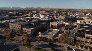 DX0001_002016 - 5.7K stock footage aerial video pass a row of brick office buildings and shops in Fort Collins, Colorado
