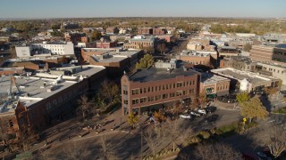 DX0001_002017 - 5.7K stock footage aerial video slowly flyby a row of brick office buildings and shops in Fort Collins, Colorado