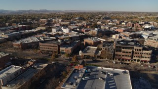 DX0001_002020 - 5.7K stock footage aerial video approach a row of brick office buildings and focus on shops in Fort Collins, Colorado