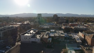 DX0001_002024 - 5.7K stock footage aerial video flying by shops with view of taller office buildings in Fort Collins, Colorado