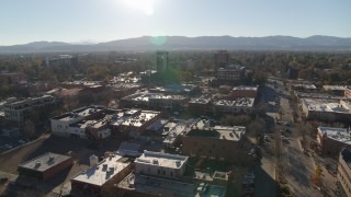 DX0001_002025 - 5.7K stock footage aerial video flying away from shops with view of taller office buildings in Fort Collins, Colorado