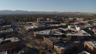 DX0001_002026 - 5.7K stock footage aerial video approaching shops and office buildings in Fort Collins, Colorado