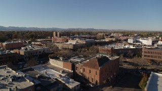 DX0001_002028 - 5.7K stock footage aerial video of an approach to shops and office buildings in Fort Collins, Colorado