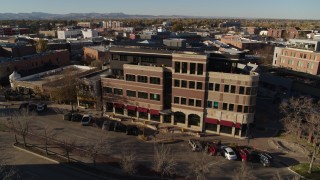 DX0001_002031 - 5.7K stock footage aerial video of passing a brick office building in Fort Collins, Colorado