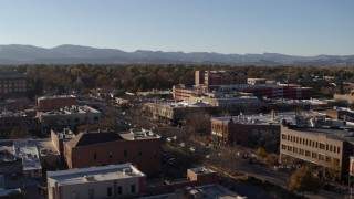 DX0001_002033 - 5.7K stock footage aerial video flyby and away from a brick office buildings and shops in Fort Collins, Colorado