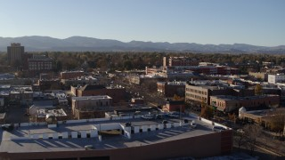DX0001_002034 - 5.7K stock footage aerial video reverse view and flyby a brick office buildings and shops in Fort Collins, Colorado