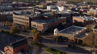 DX0001_002041 - 5.7K stock footage aerial video of a brick office building and shop in Fort Collins, Colorado