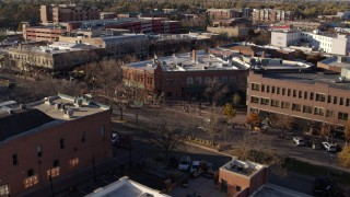 DX0001_002043 - 5.7K stock footage aerial video of flying by brick office buildings and street level shop in Fort Collins, Colorado