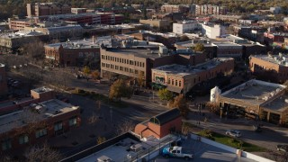 DX0001_002044 - 5.7K stock footage aerial video of a view of brick office buildings and street level shops in Fort Collins, Colorado