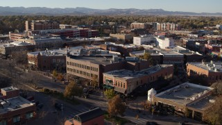 DX0001_002045 - 5.7K stock footage aerial video of passing brick office buildings and street level shops in Fort Collins, Colorado