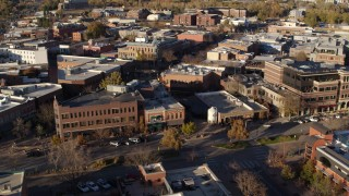 DX0001_002047 - 5.7K stock footage aerial video reverse and flyby brick office buildings and street level shops in Fort Collins, Colorado