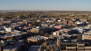 DX0001_002048 - 5.7K stock footage aerial video of flying by several brick office buildings and street level shops in Fort Collins, Colorado