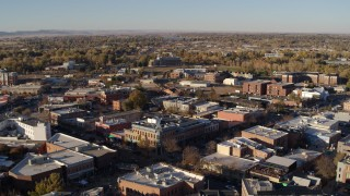 DX0001_002049 - 5.7K stock footage aerial video of passing by several brick office buildings and street level shops in Fort Collins, Colorado